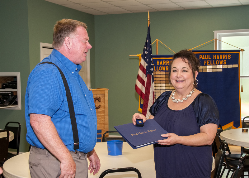 Dana Benfield was awarded Rotary International's highest award, the Paul Harris Fellow Award, by Matt Cooksey, Area Assistant District Governor, at their regular meeting on June 19th.