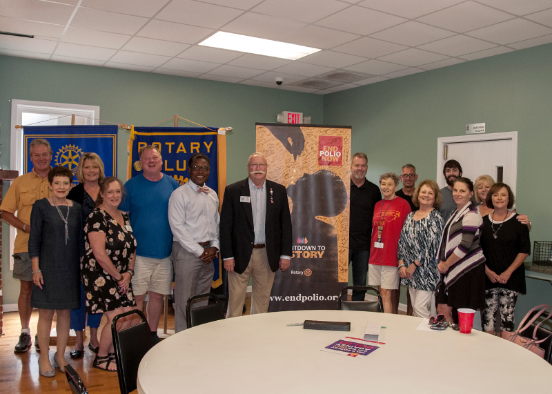 Past District Governor Tom Smith pictured with the Taylorsville Rotary Club and the 'End Polio Now'  Banner